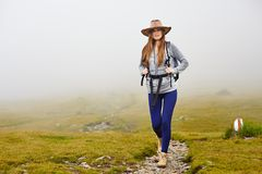 Female hiker on a mountain trail Stock Photos