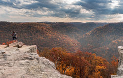 Female Hiker overlooks forest at Coopers Rock State Park WV stock image