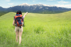 Female hiker pointing at the mountain Royalty Free Stock Photo