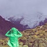 Female hiker put on jacket Royalty Free Stock Images
