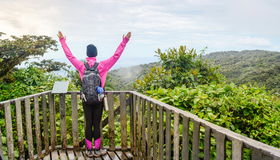 Female hiker raising hands Stock Photos