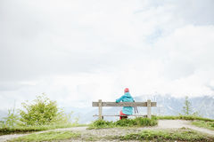 Female hiker resting on bench Stock Image