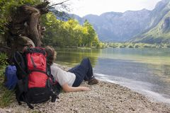 Female hiker resting at a mountain lake Stock Photos