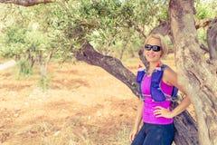 Female hiker resting on tree, Crete Island, Greece Royalty Free Stock Photo