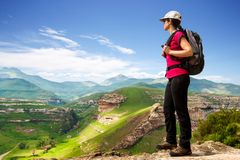 Female hiker on rocky cliff. Royalty Free Stock Photography