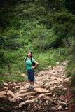 Female hiker on a rustic trail in Costa Rica Royalty Free Stock Photography