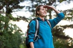 Female hiker shielding her eyes Royalty Free Stock Image