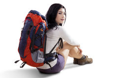Female hiker sitting in the studio Stock Photography