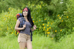 Female hiker smiling at the camera in nature Stock Image