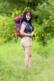 Female hiker smiling at the camera Royalty Free Stock Photos