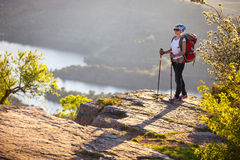 Female hiker standing on cliff Royalty Free Stock Image