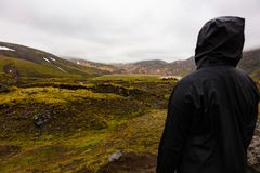 Female Hiker Standing On Rock While Enjoying Nature At Iceland Royalty Free Stock Images
