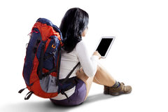 Female hiker with tablet in studio Royalty Free Stock Photography