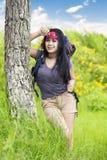 Female hiker take a break under a tree Royalty Free Stock Photo