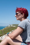 Female Hiker takes a break on coastal path Stock Photos