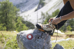 Female hiker tying boot laces royalty free stock photos