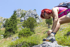 Female hiker tying boot laces Stock Photo