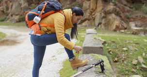 Female hiker tying her laces Stock Photos