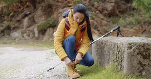 Female hiker tying her laces Stock Image