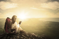 Female hiker using tablet at mountain Stock Image