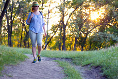 Female Hiker walking on Trail at Sunset Stock Photography
