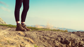 Female hiker wearing hiking boots Stock Photos