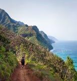 Female Hikers on Kalalau Trail Kauai. Kalalau trail path on Na Pali coast with three female hikers royalty free stock photography