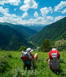 Female hikers rest and enjoy landscape Stock Photo