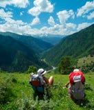 Female hikers rest and enjoy landscape. In Svaneti, Georgia Stock Photo