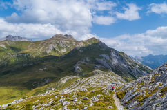 Female hiking in the mountains of Lechtal Alps, Austria Royalty Free Stock Photography