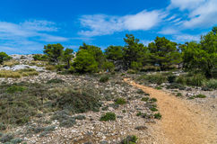 Female hiking in the mountains of Tramuntana, Mallorca, Baleares, Spain Royalty Free Stock Image