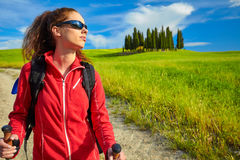 Female hiking woman happy and smiling during hike trek on Toscan Stock Image