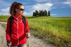 Female hiking woman happy and smiling during hike trek on Toscan Royalty Free Stock Photography