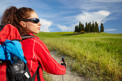 Female hiking woman happy and smiling during hike trek on Toscan Stock Photo