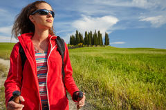 Female hiking woman happy and smiling during hike trek on Toscan Royalty Free Stock Photos