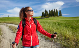Female hiking woman happy and smiling during hike trek on Toscan Royalty Free Stock Photo