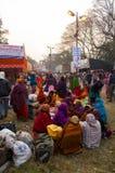 Female Hindu devotees gossiping. BABUGHAT, KOLKATA, WEST BENGAL / INDIA - 9TH JANUARY 2013 : Female devotees gossiping  on 9th January, 2013 at Babughat, Kolkata Stock Photo
