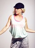 Female Hip Hop Dancer Against Gray Background Stock Photography