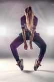 Female Hip Hop Dancer with Hair Covering her Face Stock Image