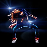 Female hip hop dancer. Neon fractal artwork, spot lights at background with rays and flare Royalty Free Stock Image