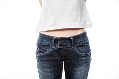 Female hips in blue jeans Royalty Free Stock Photos