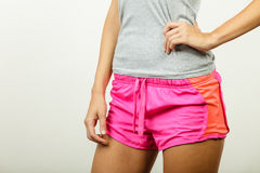 Female hips in sporty shorts Royalty Free Stock Photo