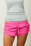 Female hips in sporty shorts Stock Photos