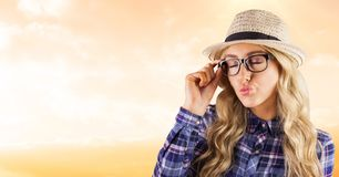 Female hipster wearing eyeglasses while puckering lips Royalty Free Stock Image