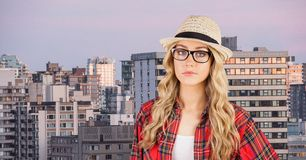 Female hipster wearing eyeglasses and sunhat in city Stock Photos