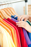 Female hispanic customer looking for clothes Stock Images