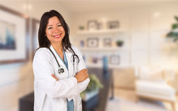 Female Hispanic Doctor or Nurse Standing in Her Office royalty free stock photos