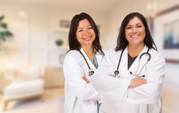 Female Hispanic Doctors or Nurses Standing in an Office Royalty Free Stock Images