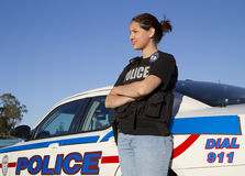 Female Hispanic Police Officer Stands Beside Her Car Royalty Free Stock Images
