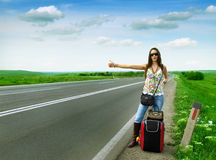Female hitch-hiker Royalty Free Stock Photos